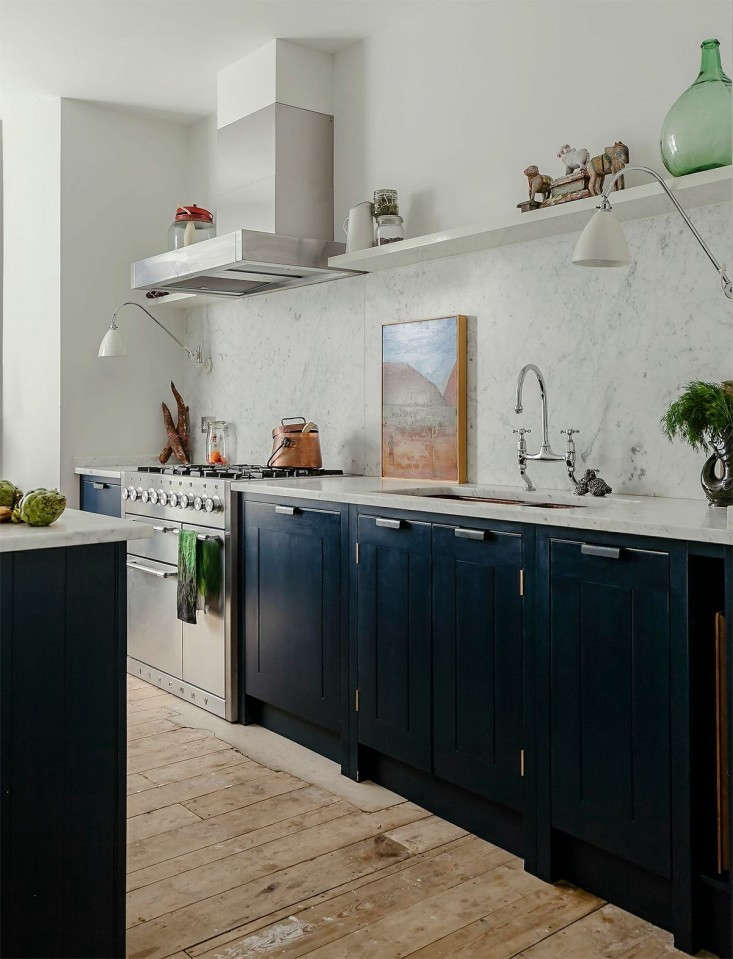 Skye Gyngell of London restaurant Spring (and formerly of Petersham Nurseries) designed her kitchen with British Standard cabinets, a Mercury 00 range and hood, copper sink, and Carrara marble counters and backsplash.