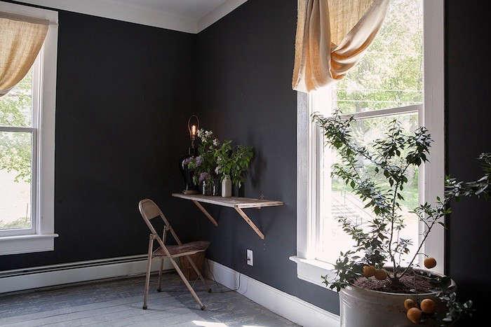 a wall mounted shelf serves as a small desk. 11