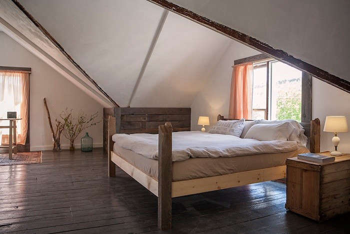 the king size bed is made from reclaimed wood. 19