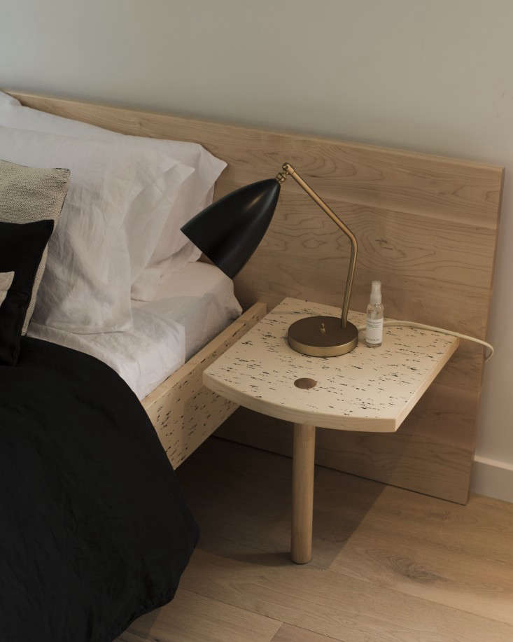the apartment bedside table