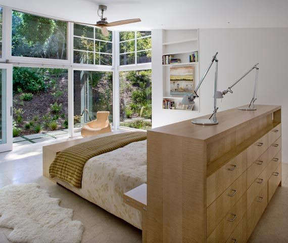 San Francisco architects Turnbull Griffin Haesloop incorporate bedside tables and a dresser into the headboard of a bed, which also acts as a room partition.Photograph by David Wakely, courtesy of Turnbull Griffin Haesloop.