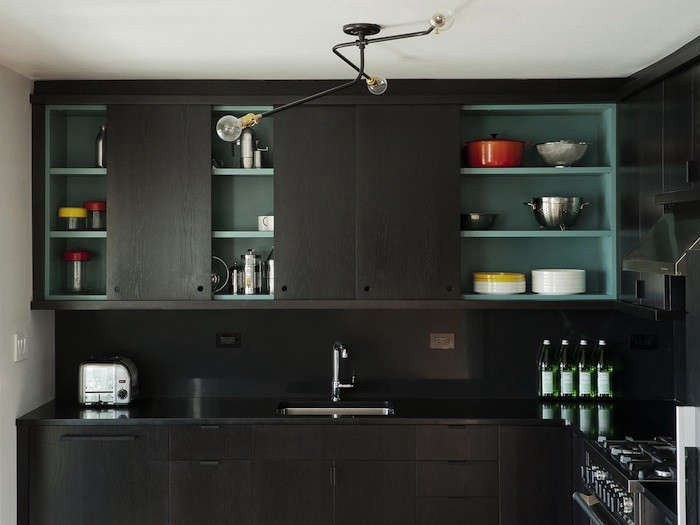 Cabinet noir: another Workstead project with cutout cabinet pulls.
