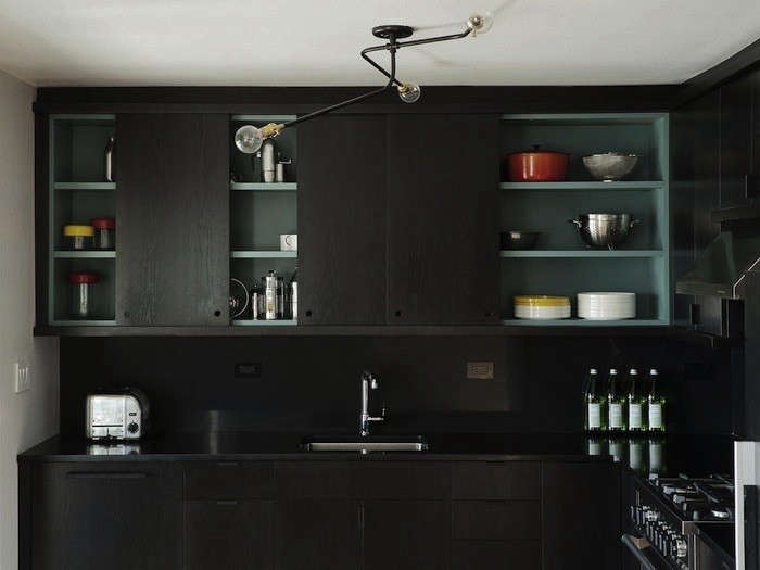 A kitchen designed by Brooklyn-based Worksteadfeatures black cabinetry and backsplash.Photograph by Matthew Williams,courtesy of Workstead.