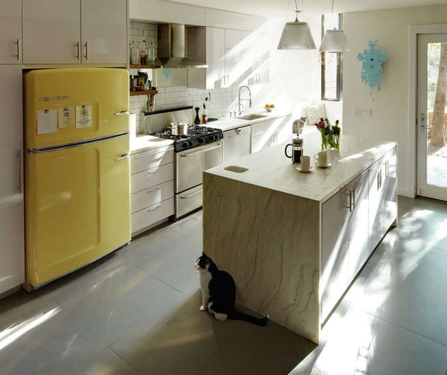 An Original Fridge by Big Chill, shown here in Buttercup Yellow and available in seven other colors. Photograph via Big Chill supplier Mission West Kitchen & Bath.
