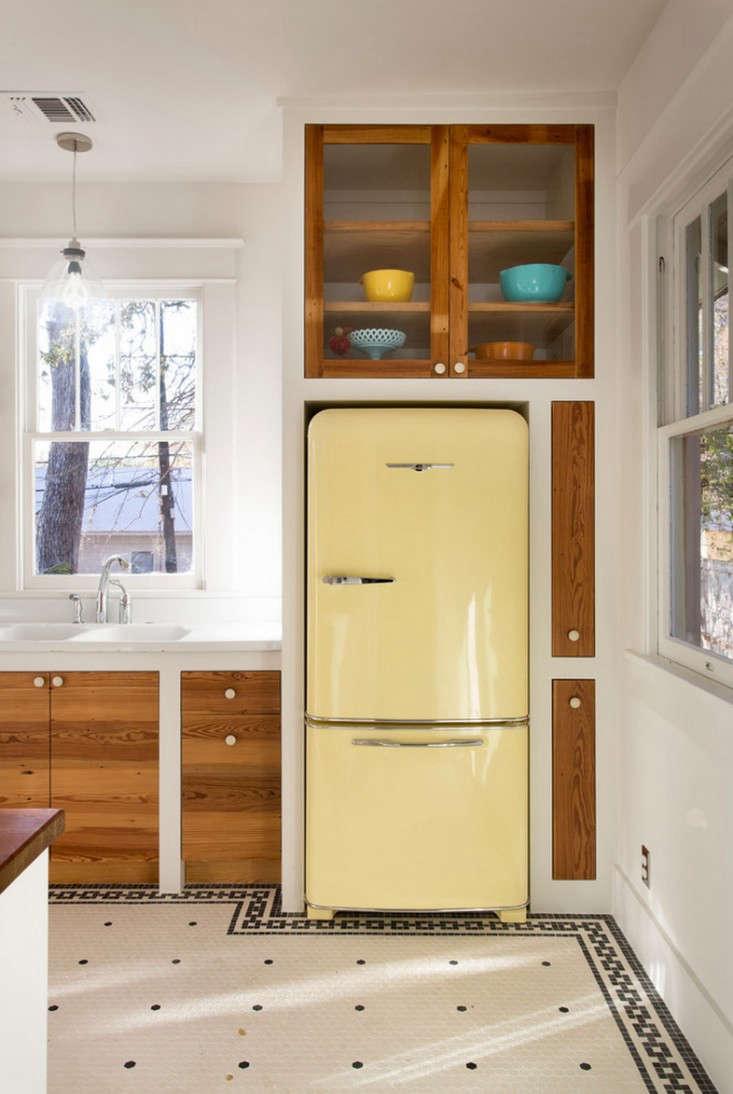 Pastel yellow in a kitchenby Hello Kitchen. Photograph by Whit Preston.