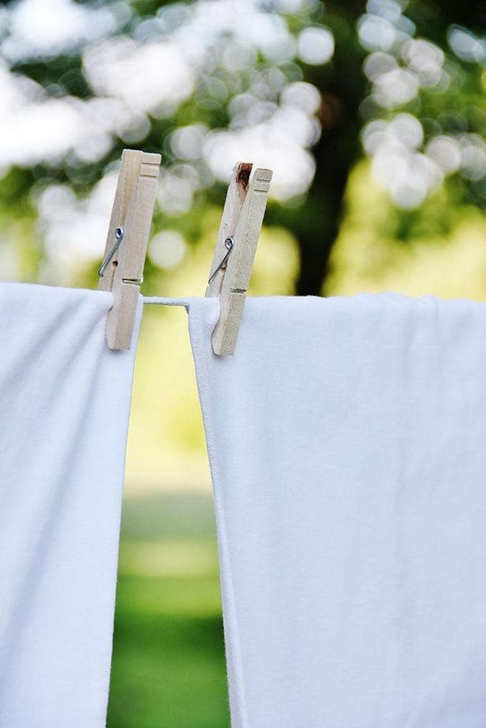 Clothespins and sheets on laundry line