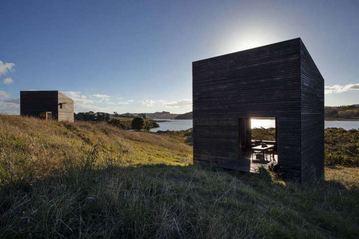 A series of charred wood cabins in northern New Zealand by Cheshire Architects from Top of the Lake: Tiny Cabins in Dark and Light.