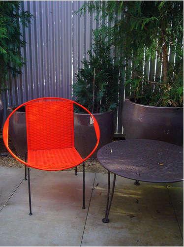 flora grubb red chair