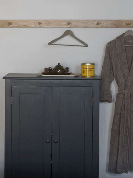 ilse crawford gray cupboard