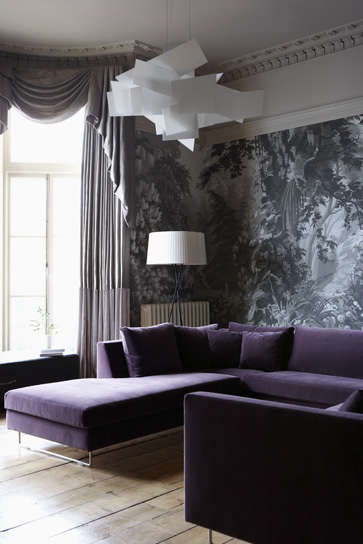 purple velvet sofa with wallpaper