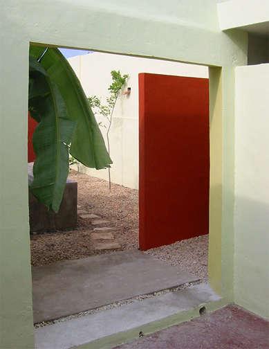 red door from courtyard merida house