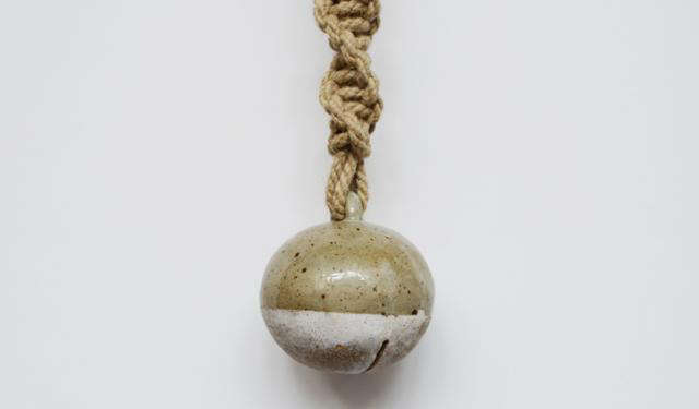 640 detail of dipped jingle bell on twisted rope stoneware