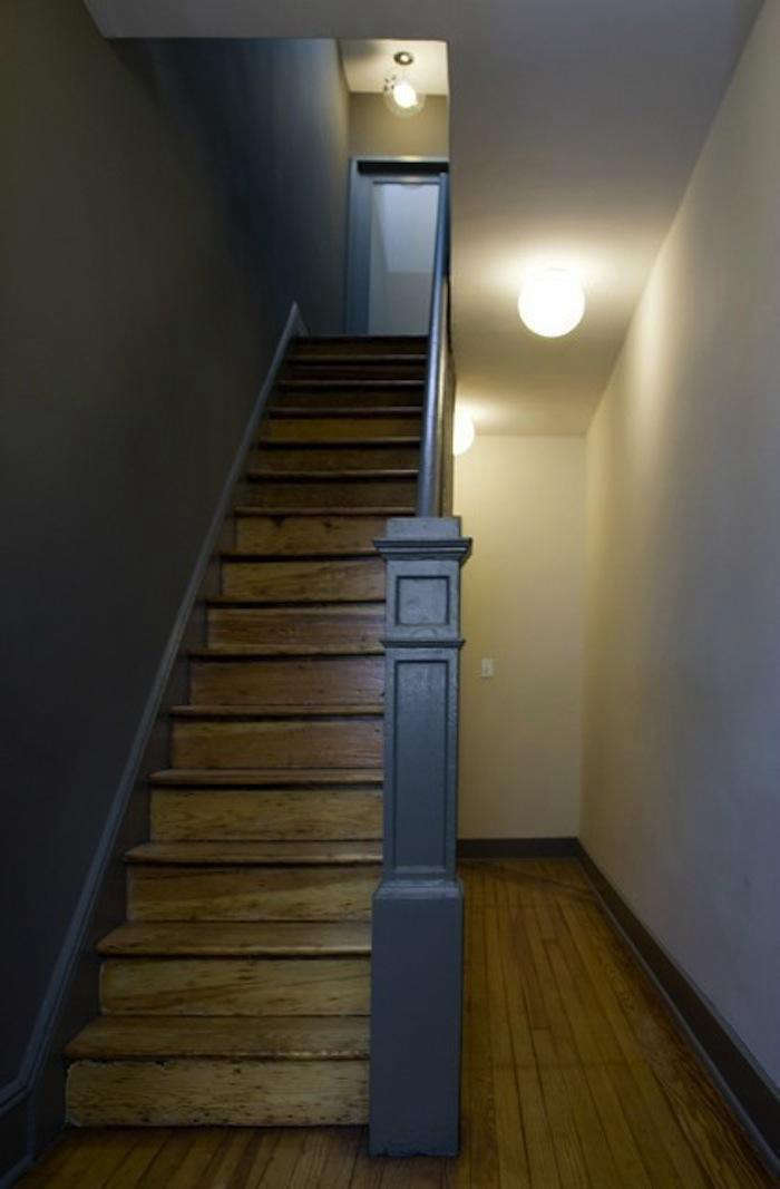 700 front studio worn oak stairs with dark gray painted wall