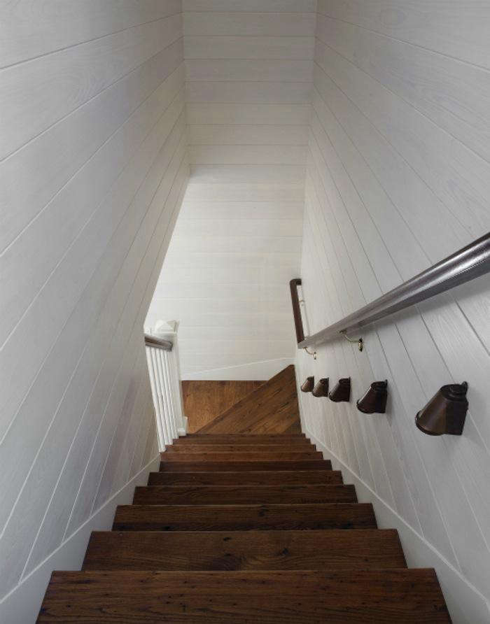 700 wettling architects shelter island worn stair with white painted interior siding