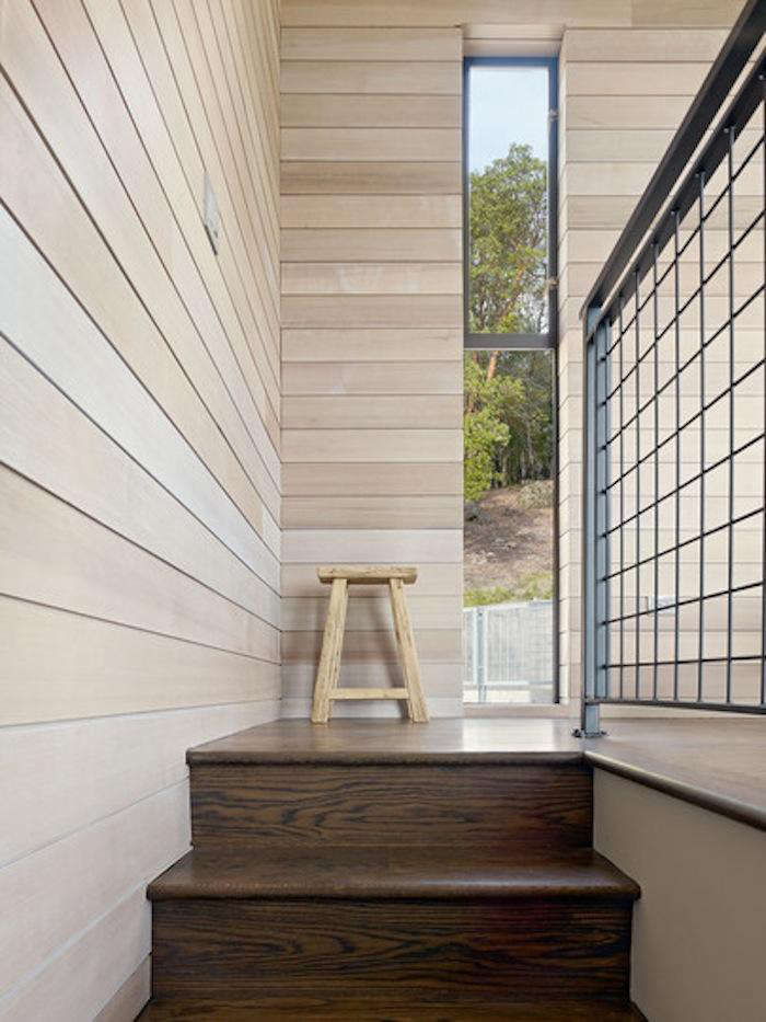 700 zack de vito lk house stair with light wood paneling and dark wood stairs