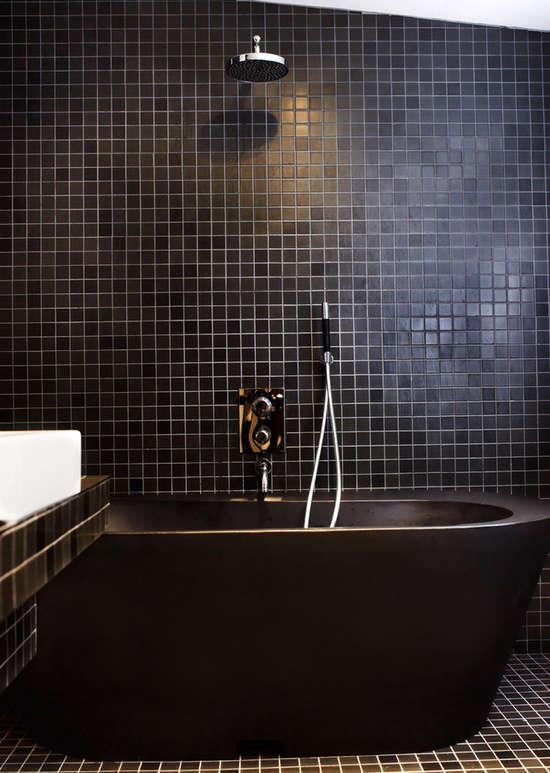 black tub black tiles