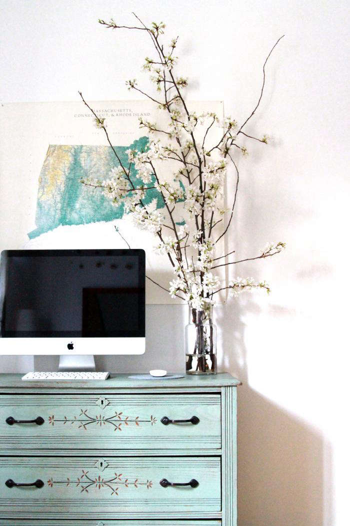 700 cherry branches next to computer