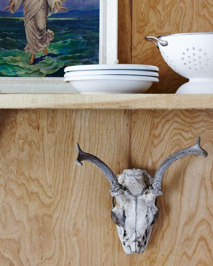the rough wood shelves hold a collection of white dinnerware; one of hannotte&a 14