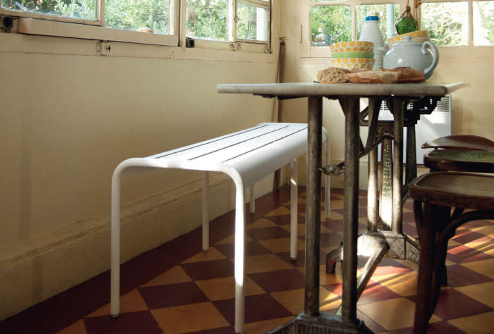 700 white fermob bench used indoors