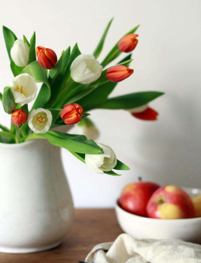 700 tulips on table with fruit
