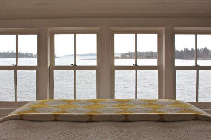 The summer bed, refreshed; see more in A Cottage Reborn in Coastal Maine.