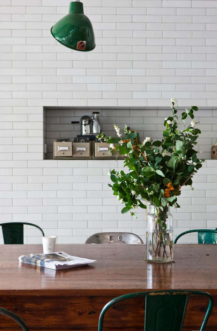 AtMarket Lane Coffee in Melbourne, a recessed tiled nook adds storage for kitchen necessities.