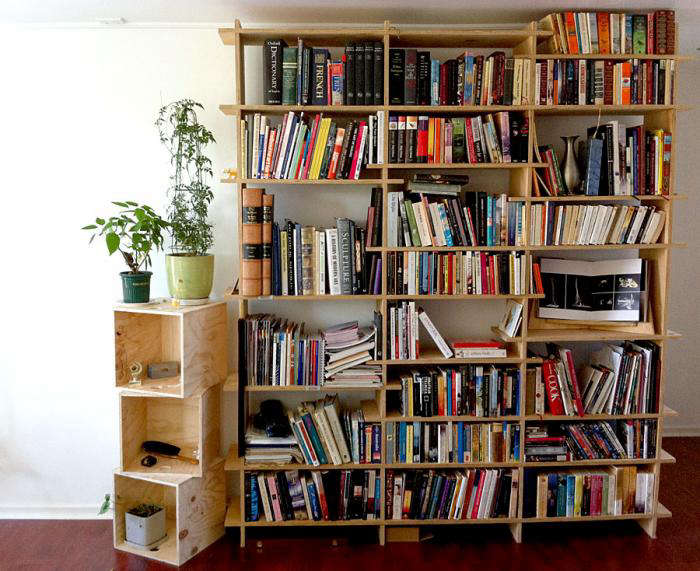 700 plywood shelves with books like butter