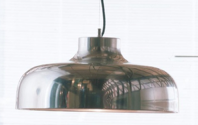 shiny silver pendant in situ photo