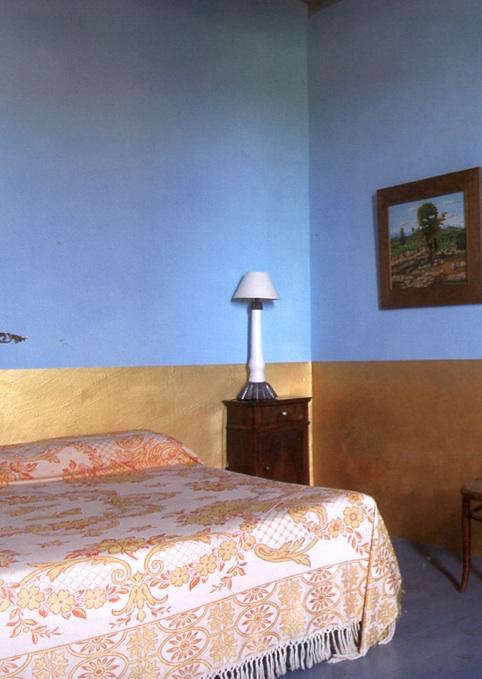 gold painted wall blue