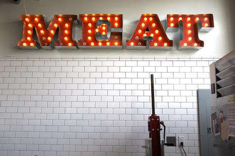 olympic provisions meat sign