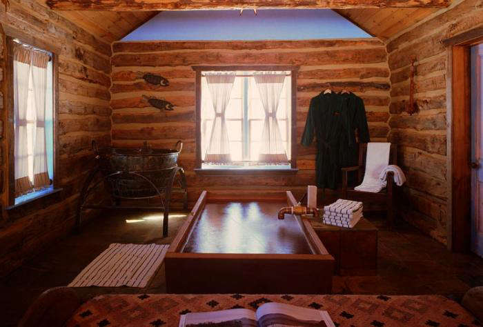 Guest rooms feature hot springs water piped into wood tubs.