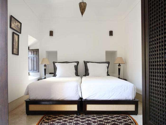 700 riad dix neuf bedroom white sheets