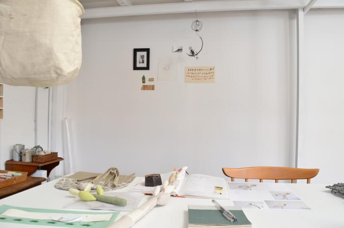 A canvas vacuum bag hangs over Akatsuka&#8
