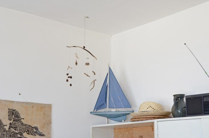 A small DIY mobile of shells, driftwood, and objects from the sea becomes a natural sculptural element in this quiet flat in France. SeeInspired by the Sea: At Home with an Artist in France.