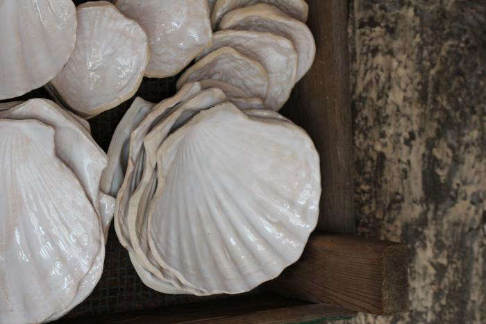 Steal This Look Parisian Oyster Party Ceramics are molded from beach shells, then coated in a high gloss white glaze.