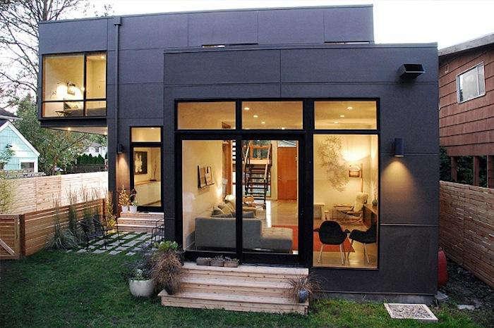 700 malboeuf bowie nighttime backyard modern house