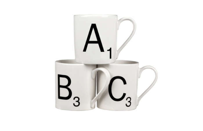 700 scrable mugs with black lettering