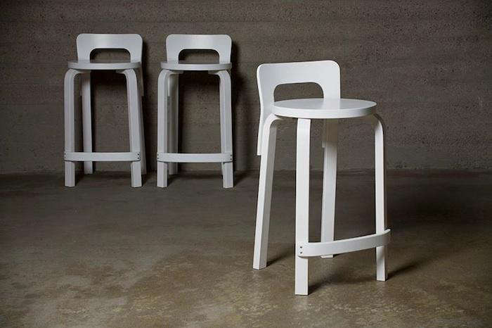 julie is admiring the artek high chair k65 stool in white. 9