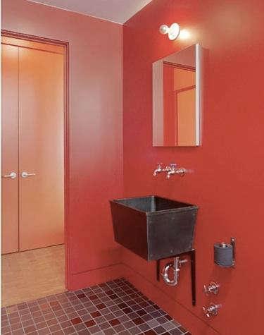envelopead bath red walls industrial