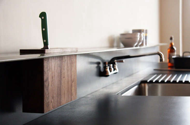 Another from Viola Park, a genius thin steel shelf that runs the length of the counter and allows for an inset knife block.
