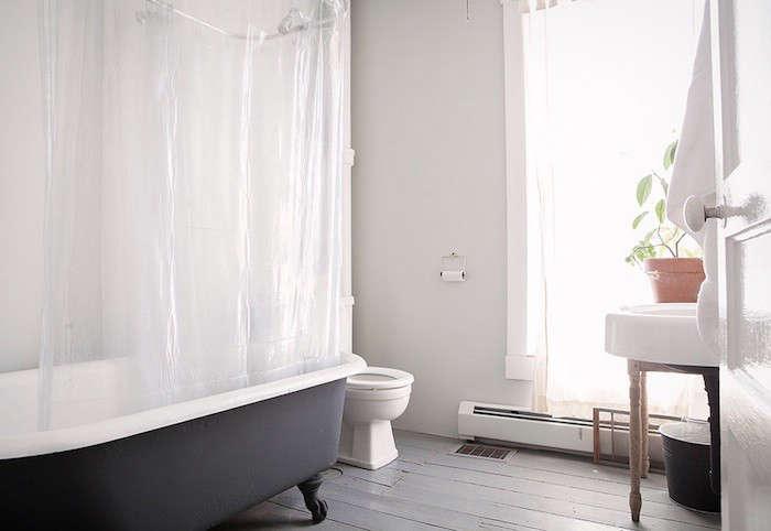 a vintage bathtub painted slate gray. 15