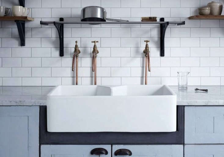 When outfitted with separate copper-pipe faucets, adjoined sink basins become separate sinks. See Steal This Look: A Classic English Kitchen for an Oscar-Winning Costume Designer.