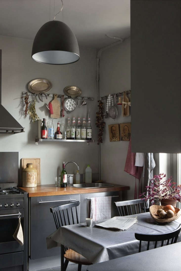 a pleasantly cluttered kitchen in a french apartment, available for rent; see c 13