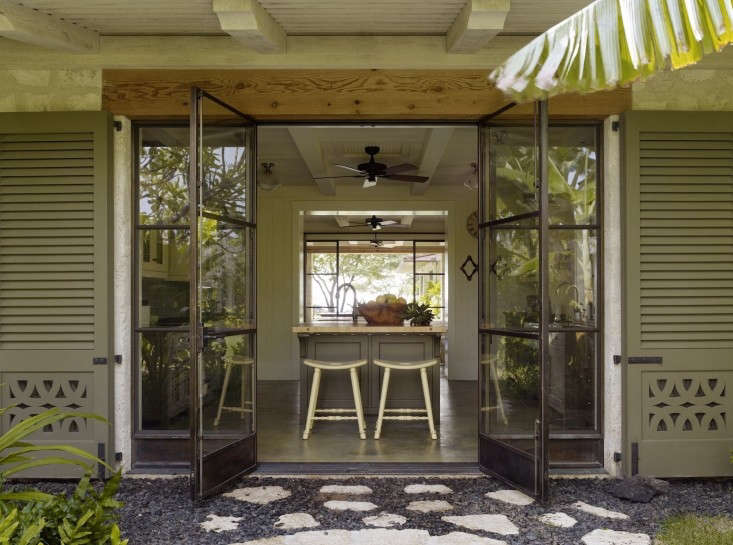 In an indoor/outdoor Hawaiian house, double doors open from kitchen to gravel courtyard. For more, see Architect Visit: Re-creating Old Hawaii on Kakapa Bay on Gardenista.
