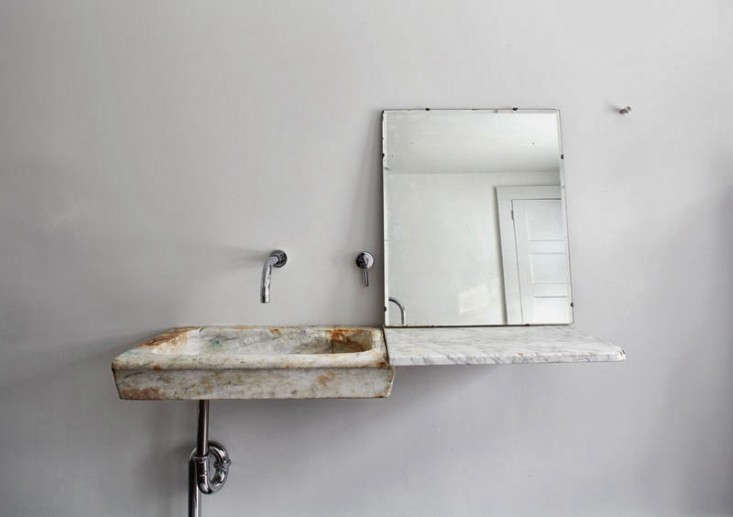 An th-century Italian marble sink connects to a floating slab of Carrara for an instant bath sculpture at the Floating Farmhouse by Tom Givone.