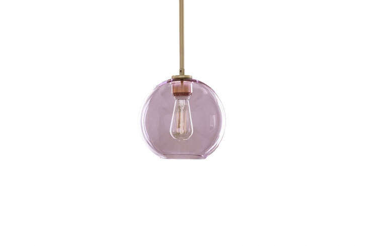 The new Sculptural Glass Globe Pendant from West Elm is available in dusty blush (shown), clear, milk glass, midnight blue, silver, and gold; $79.