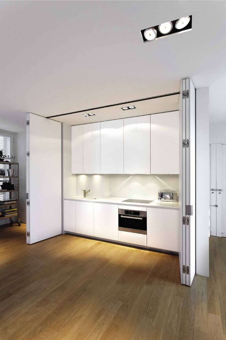 a concealed white kitchen by boffi. 18
