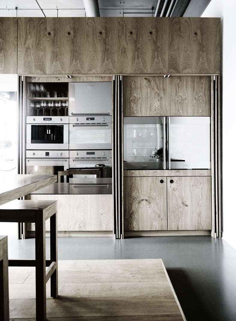 all appliances are concealed behind full length oak cabinet doors in this kitch 17
