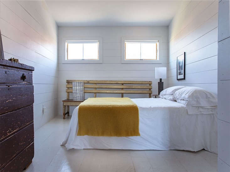 in paula&#8\2\17;s tranquil bedroom, a bench from the essex street market i 22