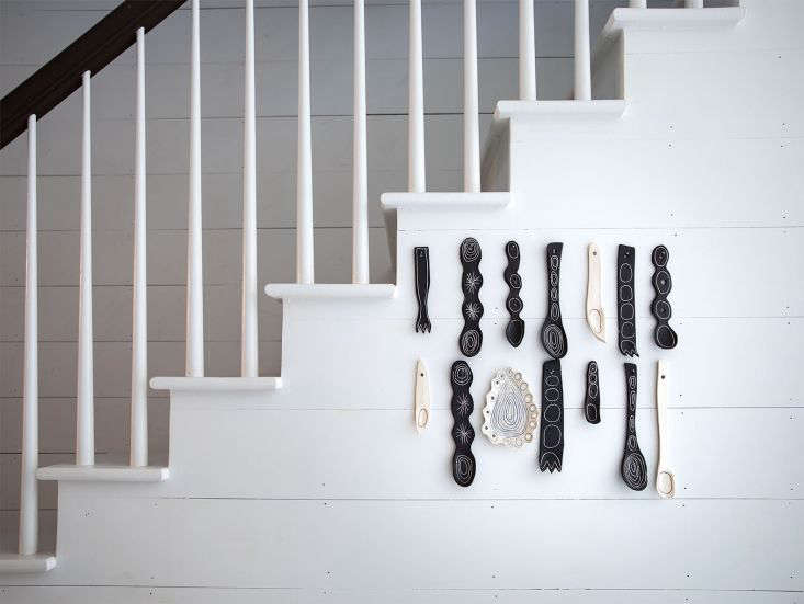 ceramic serving utensils–which look something like pieces from a children& 14
